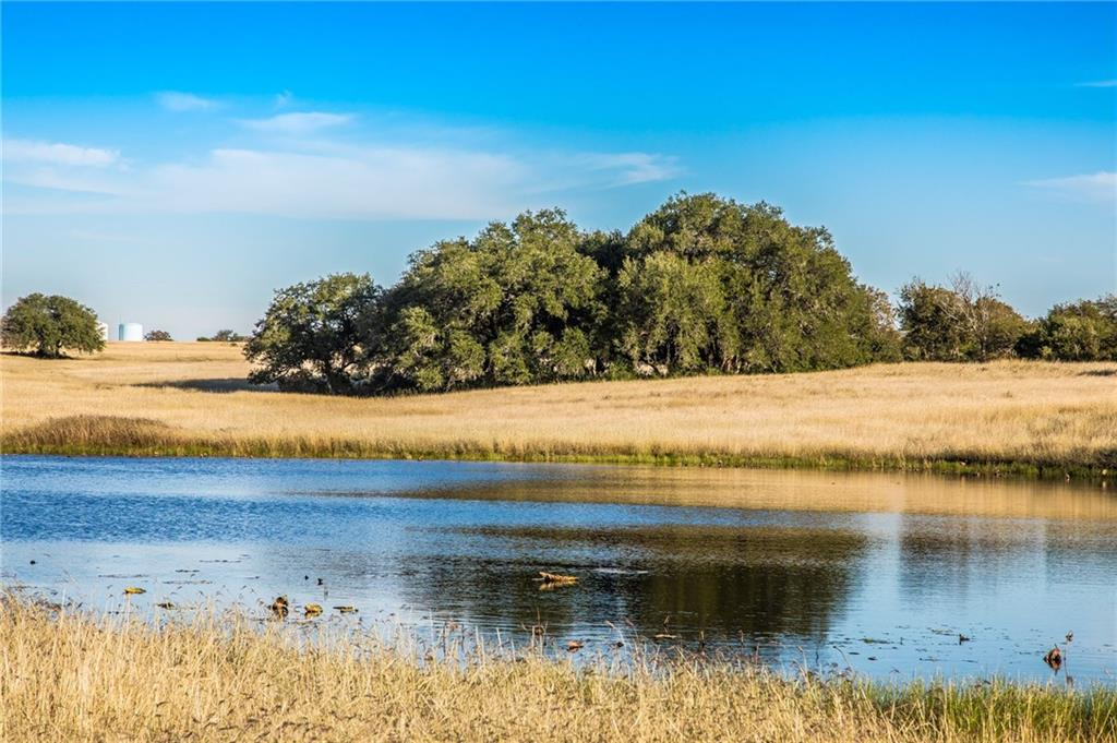 This hidden gem is tucked away within a tight knit, gated farm & ranch community. Spectacular 360panoramic views will sweep you off your feet! Majestic,historic oak tress w/limbs that touch the ground make for a fairy-tale entrance to the pristine homesite. The newly installed fishing pier invites you to make memories on the sparkling stocked pond. Horse lovers dream escape, located @ the back of the 2 mile private road w/secured gates access. Abundance of wildlife, & Ag exempt!Restrictions: Yes
