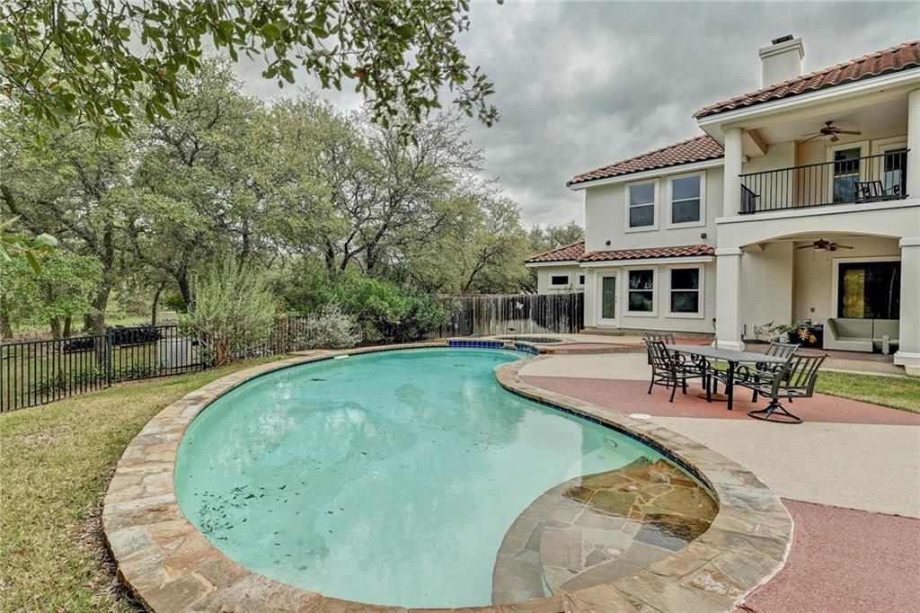 Rare opportunity to own a property with 13.87 acres, in a gated community of great neighbors who enjoy a quiet and well cared for community. Home has huge game area downstairs, media area upstairs, with cozy and inviting family room and fireplace. Bring your ATV's, horses, enjoy this beautiful land that is abundantly graced with Live Oak Trees, Buebonnets, and cactus, stairs nearby that lead you down to the water for kayaking or fishing, picnicking! Own a piece of Texas!Restrictions: Unknown  Sprinkler Sys:Yes