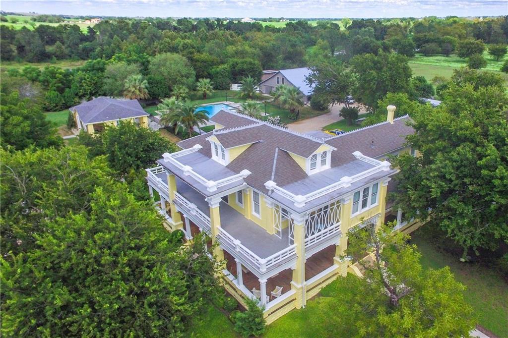 Historic Victorian-style Mansion. Wrap-around porches. Multi living areas, parlors. Stainless appliances. Crown molding, stained glass entryway arches. Luxe pool & spa, w/tropical landscaping. Beautiful cabana. Ballroom w/amazing architecture, glass walls, w/beautiful trees & pavilion - perfect for large gatherings! 1,886sf 3br/3bth lux home can be main res. Short walk to 2-ac pond. Used as party venue in past. 30m to Austin, 15m to R. Rock. City water/city sewer available, commercial/dev. possibilities.Guest Accommodations: Yes Restrictions: Unknown  Sprinkler Sys:Yes