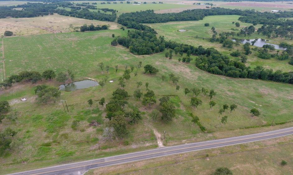 Perfect place to build your dream home/great gentlemen's ranch! This 40.9 acre tract has it all including, large oak trees scattered throughout, beautiful rolling pastures of improved coastal grass, a pond, and a wet weather creek with paved road frontage .  Water meter in place, ag exempt, great hay production. Enjoy panoramic views and lots of wildlife.FEMA - Unknown