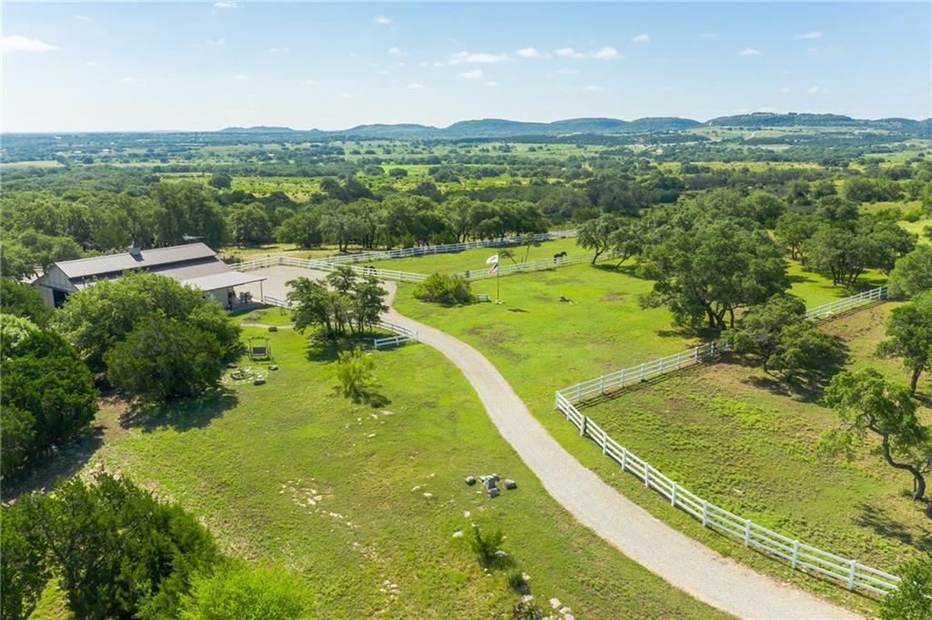 Absolute Gorgeous 25 Acres of Pristine Equine Land in the Wine/Hill Country between Johnson City & Fredericksburg. Incredible Panoramic Views. Use the Barndominium to live in while building your Dream Home, then use it for your guest house.  Retired Sellers moving back to Arizona. The perfect horse property & all the work has been done. 4350sf Barnmaster, 4 stalls, w foaling stall, 5 stall shed row barn, 4000' of white vinyl fencing, 2 ponds, 6 pastures, 4 outbuildings, gated subdivision, & much more!Guest Accommodations: Yes Restrictions: Yes