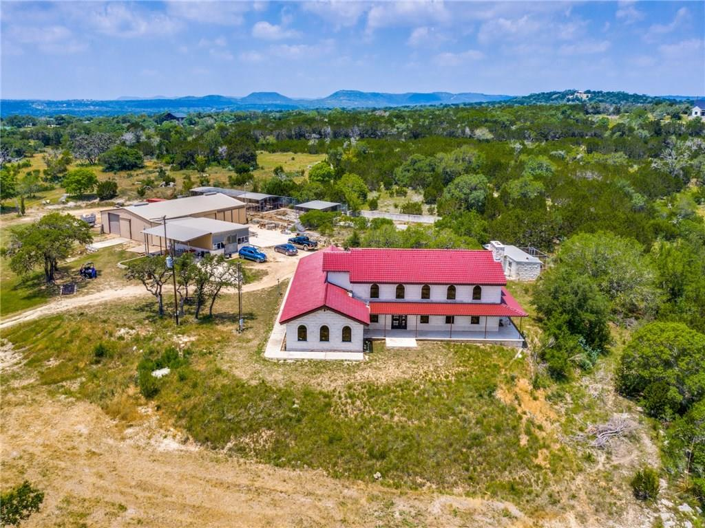 240 acres mins from Kerrville & Bandera. Private & quiet w/ hill top views. Custom built 3/2 home feat. soaring ceilings, clay tile roof, windows & doors imported from Germany, Italian floor tiles, giant game room & more. 2 add. storage bldgs w/elect. & water & a 4 horse stable, equip bldg feat. worker's qtrs & bldg for hay storage. Pipe cattle pens, 2 water wells, fields & valleys w/ great usable land. Would support air runway. Crystal clear creek w/ springs, fishing holes & waterfalls.Guest Accommodations: Yes Restrictions: Unknown