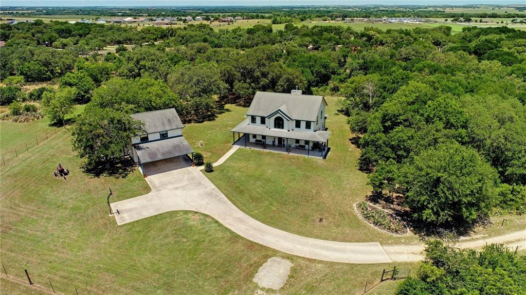 Remarkable acreage with stunning live oaks, wet weather creek, and open grassland. Custom built home offers plenty of space for family living living and entertainment.  The flex space upstairs was built to be easily converted into 2 bedrooms. Recent interior/exterior paint with master bath update. Detached 3 car garage includes a great workshop along with an awning for added covered parking.  The 2 bedroom apt above the garage sets up perfect for income producing rental, multi-gen living, or added office.Guest Accommodations: Yes Restrictions: Yes