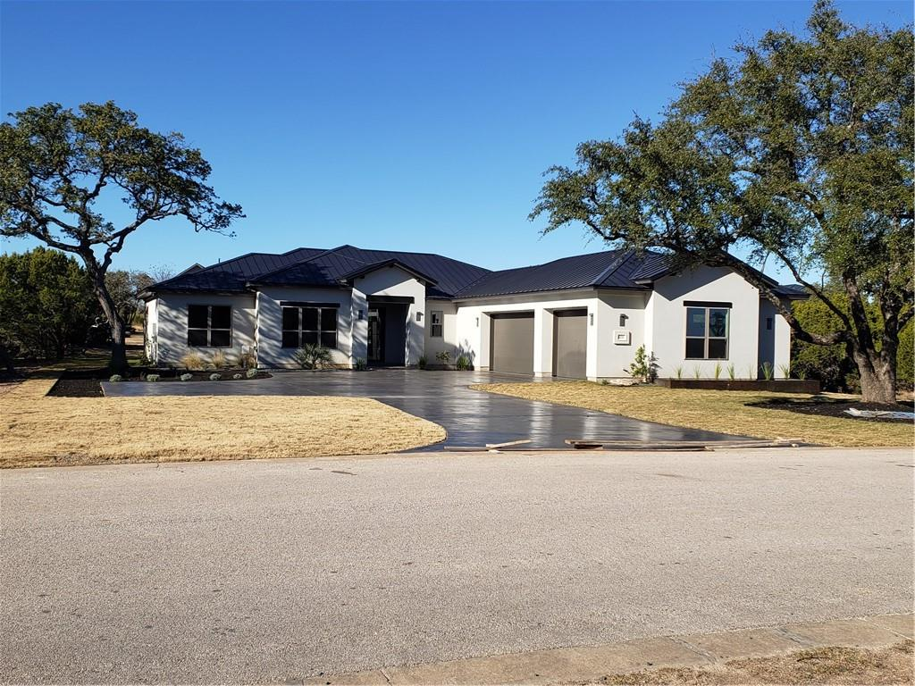 Live where you play and every day can feel like a holiday. This custom Hill Country Modern home is located in the prestigious gated lakefront community of Waterford On Lake Travis, a stroll from the marina, and near parks, trails, golf courses, airport, boating, and so much more.  On a large tree-lined lot, across from green-space area. Good bones, quality craftsmanship, and high-end finishes. Work from home in the bright study sporting beamed ceilings, or entertain outdoors on the large stained porch with built-in gas grill kitchen. Recharge in the spa-like bath, or relax on the secluded lanai off the bedroom. 3-car garage and over-sized driveway for guests and toys. Level back yard with room for a pool. Move-in ready by 10-10-2020
