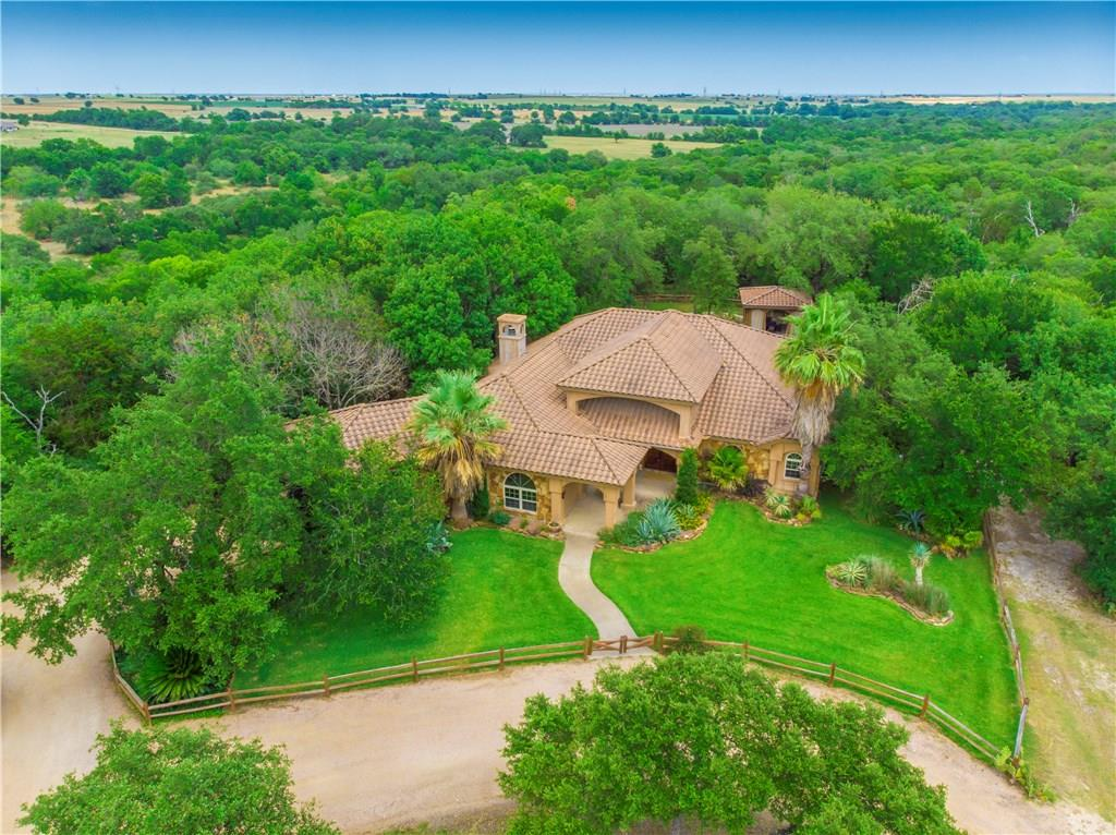 Custom Texas style home on over 43 acres (two parcels, one lot is 29.84 acres and the other is just under 14 acres). Custom built home with tons of upgrades. Property has a 12 stall horse barn with office, arena, covered RV parking, septic and 1200' well and covered bbq pit area. Sprinkler Sys:Yes