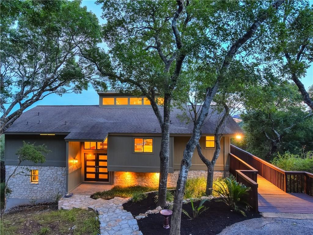 One of a kind property! Secluded hilltop retreat close to DT with end of road total privacy and panoramic views! 2.6+/- Estate acres spanning from  crest of Spiller Hill to Bee Caves Rd. Classic Mid-Century Modern built by AD Stenger & Architect Earl Nesbitt. Miles of stunning 180 degree City views, watch Zilker fireworks from upper deck, distant City lights are beautiful, walls of windows, 3 unique decks, xeriscaped. Ready for your personal renovation or charming as is. Bonus log cabin hidden in woods!Restrictions: Yes