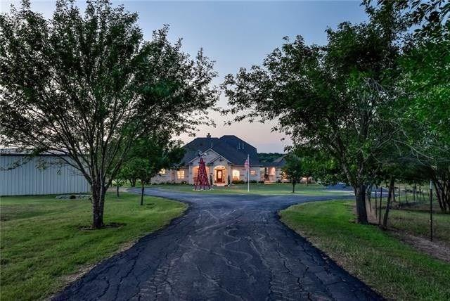 Custom-built 2 story w/separate guest quarters on a 78.4-acre Texas Gentleman's Ranch close to Austin, yet worlds away!~3 bed/2 full/2 half bath dwn. Owners suite +=sep. shower, garden tub, granite. Up=media room & game room w/wet bar, & balcony. Open Gourmet center-island granite w/bfast bar, 2 offices. Recent wide-plank floors, shutters, & fresh paint. Roof (2014), the AC down (2019)~ Guest house has 2 mini split AC's, full bath w/roll-in shwr, wood flrs. Barns, 80X30 wrkshp/2Car gar/carport.FEMA - Unknown Guest Accommodations: Yes