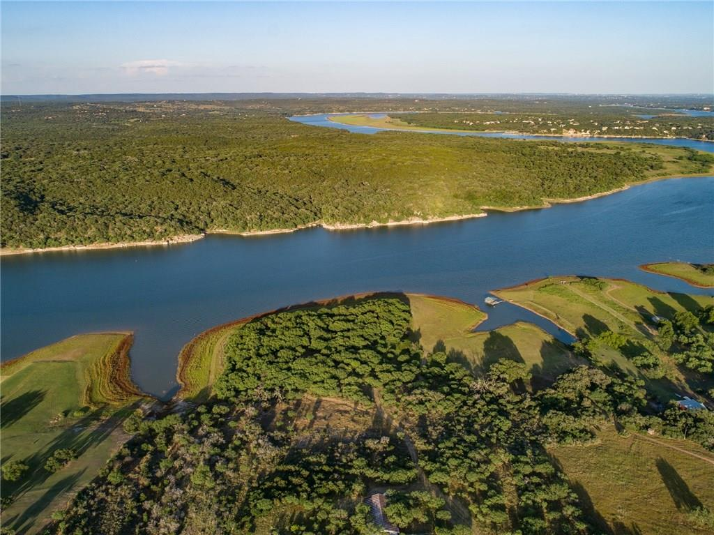 Directly across lake from Turkey Bend Recreation Area, protected viewsheds and unspoiled shorelines create an unmatched sense of privacy yet accessibility along the growth corridor of SH 71. The ranch boasts approximately 3,500 feet of Lake Travis shoreline with several fantastic locations to improve boat docks, ramps, and other access to the recreational waters of Lake Travis. Cool clear waters of spring-fed Alligator Creek run yearlong along the north edge of the property as it merges into Lake Travis.