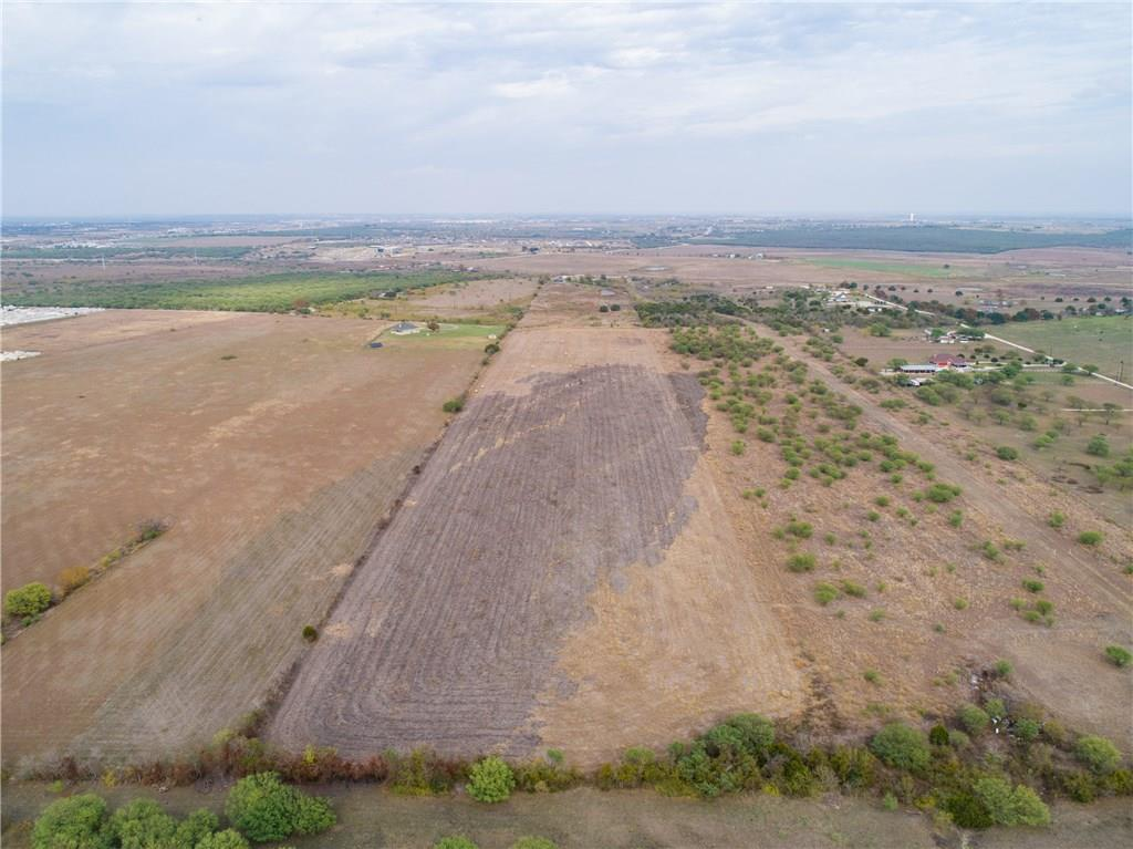 "150 Lot Preliminary Subdivision Layout has been completed! Price will continue to increase the closer we get to subdivision approval! Get your offer in now to join in on the design and development process! Great Investment Opportunity 40 minutes south of Austin! 6 minutes from the San Marcos Outlets mall and retail shopping! New state-of-the-art elementary school and a new home community developed by Trace within walking distance! This beautiful 42 acre farm land property offering some hill country views is just screaming, ""Develop Me!"" The property is also located 15 minutes from downtown San Marcos and Texas State University! And last, but not least, Schlitterbahn Waterpark is is only 45 minutes away!"