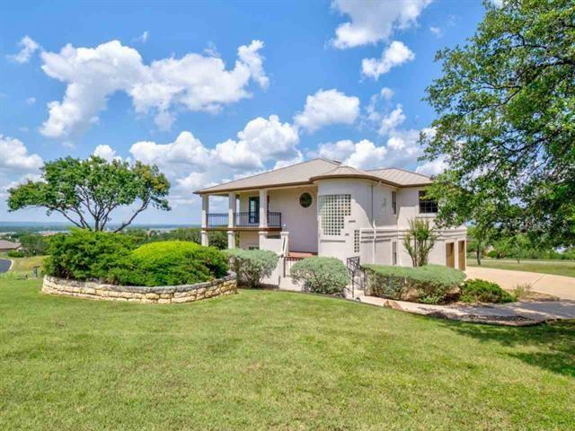 Gorgeous Lake LBJ Views from this Two-Story Home with Great Rooms on each level, Wood Burning Fireplace & French Doors that lead out to the Wrap Around Porches/Balconies. Two Car Garage with Golf Cart Garage. Located just down from the Applehead West Community Pool & Tennis Courts. Includes a Waiver of Initiation to the HSB Resort Club (upon approval & acceptance) Kitchen Refrigerator, Washer & Dryer convey. Adjacent lots are negotiable with an acceptable offer on 3305 Close Call.Restrictions: Yes