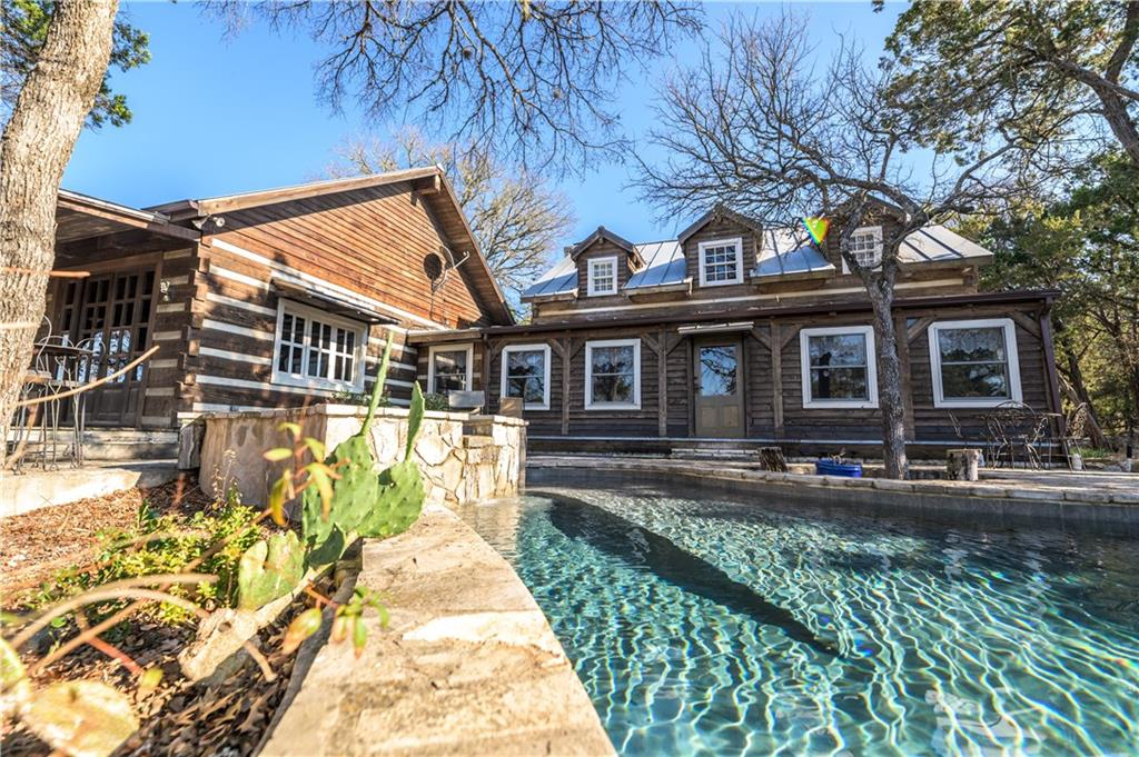 Three private ranch tracts on Cypress Creek together with a beautiful hardwood timber home makeup this spectacular proeprty. This property is a strong investment with one of the finest timber-framed homes in central Texas. The 3,332 sqft home was constructed by Hearth Stone Homes of Dandridge, TN with 4 bedrooms, 3.5 baths, 100 year old longleaf pine floors, mortise and tenon constriction, and a gorgeous pool overlooking the creek. The adjacent Livery has a 3 bay garage, workshop, and a 1/1 guest suite.Guest Accommodations: Yes Restrictions: Yes