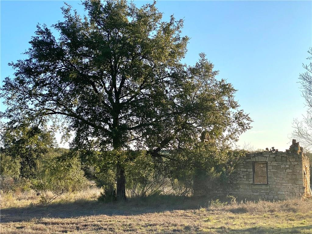 10 ACRE LOT WITH A TON TO OFFER! Electrical service on sight that allows for home to be built in a secluded area! Private gate located past the main entrance of Stone Ridge Mountain for more private access. Land cleared of many cedars, and a large spot is also ready for a home to be built. Native and Heritage oaks galore on sight. Old stone house on property that would make into a great outdoor bar, or kitchen. Deer and turkey have been spotted on the property. Ag exempted and bow hunting is allowed.Restrictions: Yes