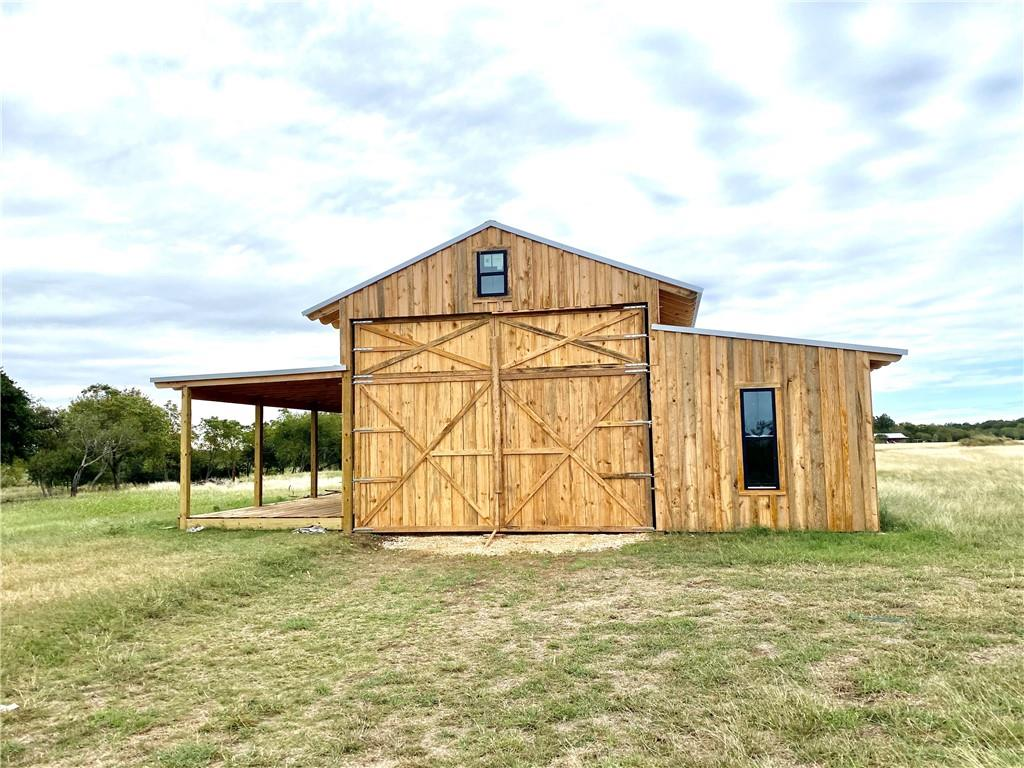 SAN MARCOS GETAWAY RANCH! Rare waterfront 20 acres ON the Blanco River.. Prime location less than 3 minutes from San Marcos and I-35. Super Low Taxes, Ag Exempt! This is a true MUST SEE property. The owners just had a stunning 44x50 pole barn built with pine wood, 14' ceilings, & 8 custom barn doors! Park an RV inside & live the dream or finish it out how you want it. Peaceful country setting with abundant wildlife and views of the properties 870 feet of river access. An open pasture of possibilities awaits .. Site built and tiny homes allowed. Low restrictions. Outside city limits - no sewer. Underground electricty and water available on site. Come experience this riverfront retreat!!