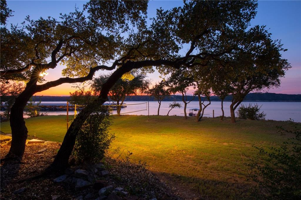 An amazing opportunity to own a great waterfront estate, whether homestead or as an STR property, on the south shore of the beautiful Lake Travis! Be the owner of your very own mini-resort on a beautifully situated 2+ acres with over 330ft of shoreline. 3 separate units totaling 4 bedrooms, 4 full bathrooms, and 3 kitchens complement these manicured grounds. Property comes with its own dock, and the smooth ramp makes for easy walking to water or boat launching.