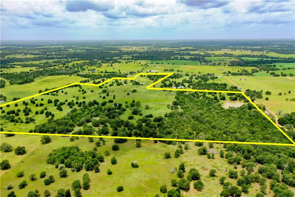 Rare find between Paige and Lincoln! Gorgeous rolling acreage with ponds, trees, clearings and views within an hour of Austin and College Station, only 24 minutes to Bastrop. Perfect for your beautiful new country homesite! Ag exempt for low taxes, county water available at street, electricity on adjacent properties, septic needed.  Restricted against mobile/modular/manufactured homes.  Ask about other seller-imposed restrictions.Restrictions: Yes