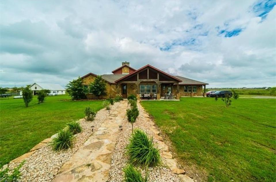 """AMAZING ranch, all custom home """"one of it's kind"""", very elegant and must love cedar wood beams! The home feels like your in a lodge up in Colorado! Its a hobby farm on 5 acres with a 4 stall barn, you can board a couple of horses for revenue, includes a 3 car garage, arena, private entrance gate, custom Kitchen made of Knotty Alder wood, 6 foot granite island, stone gas double sided fireplace, massive windows, large patio. Formal dining, office, 3 or 4 beds."""