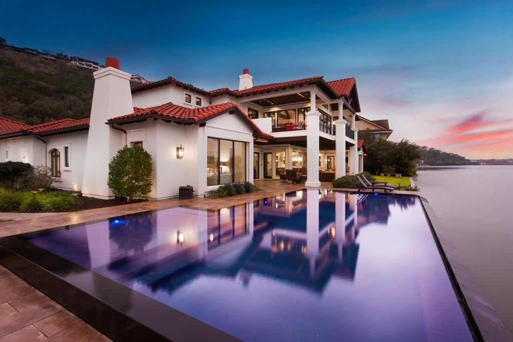 Beautiful Santa-Barbara-style estate with a contemporary feel sits right on Lake Austin in the Waters Edge neighborhood, one of the most desirable locations in the city. Sited on a .719-acre lot with 200+/- feet of shoreline on two sides, it is the epitome of lake living with utmost convenience. Include over 1600 square feet of covered patios with summer kitchen, a negative-edge pool with hidden spa, two-slip boat dock, media, game room, study & MORE. 24hr showing notice. ShimmeringCoveLakeAustin.com Sprinkler Sys:Yes