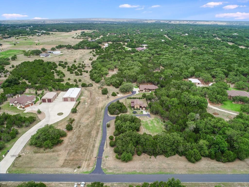 Incredible space to build your dream home! Property has 11+ acres with easy access to dining, shopping and schools! This wooded property includes stunning hill country views in all directions with lots of home site options.Restrictions: Yes