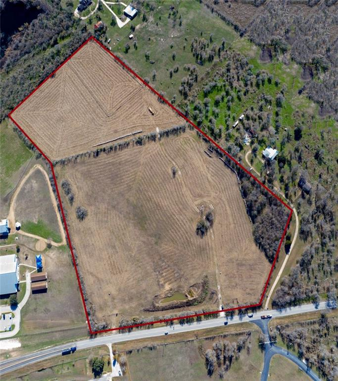 Beautiful fenced pasture land that is unrestricted located right past the Red Rock Elementary on the same side with 752 if frontage on Hwy 20. Two water lines on property. Lots of possibilities. Agents see gate code attached.Restrictions: Unknown