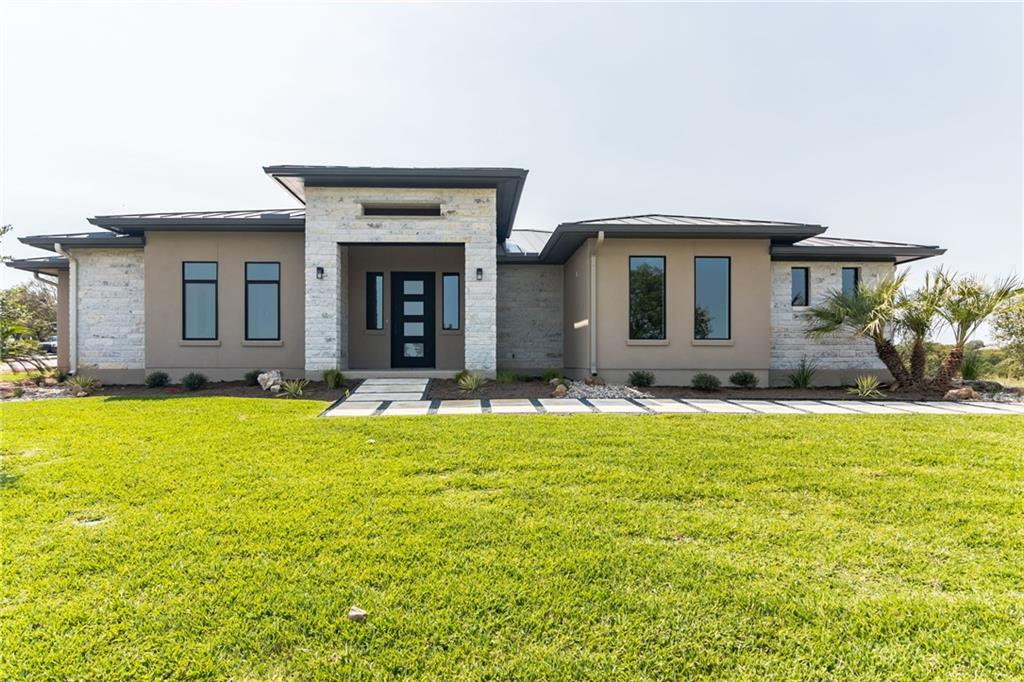 Another TOP OF THE LINE HOME BY JACKSON CUSTOM HOMES. Immaculate design with a very functional and well thought layout.When you walk into this home you will enter the grand room, which boasts high ceilings, hill country views, and a beautiful fireplace. This custom home features a split floor plan with the owner's suite being secluded from the other bedrooms. This home is located in the Bay West subdivision of Horseshoe Bay.Restrictions: Yes  Sprinkler Sys:Yes