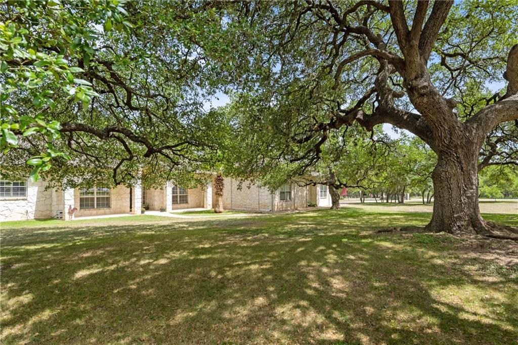 This custom built home w/ open concept sits on a gorgeous parcel w/ mature oak trees. Privacy abounds on the 4 acre lot w/ lots of shade from the majestic oaks. In addition to the 2 car attached garage, the 2,400 sf detached workshop w/ HVAC offers 5 more parking spots. It is a car enthusiasts dream! The circular drive in front of the shop allows for easy access. Gated & fully fenced w/ cross fencing, this is a perfect home for anyone looking for space while still close to amenities.FEMA - Unknown Restrictions: Yes