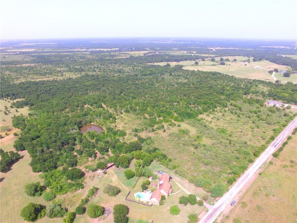 Come see this beautiful 74+/- acre property with ag exemption in place.  Gorgeous mature trees, a dry creek, and no flood plain. Light deed restrictions in place to preserve property value. Perfect for your future home, or ranch. Selling as a whole or in parcels of 11+ acres see agent for details. House located at 3601 CR 464 on 11 acres being sold separately see agent for more info.Restrictions: Unknown
