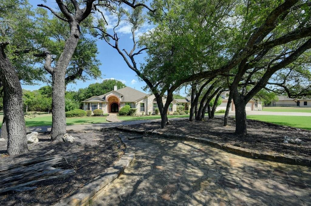 Grab your piece of the TX Hill Country with this custom home on 3+ acres in a gated community 45min to DT Austin! Hand scraped wood floors in family room, tongue & groove stained ceiling in game room, crown molding in all 4 bedrooms and the dining room, granite counter tops in the kitchen. 5 car garage, gardens and koi pond, large back patio with fireplace and built in grill, fire pit, manicured/lush yard! Electrical panel ready for a pool! Acclaimed Liberty Hill ISD!Guest Accommodations: Yes Restrictions: Yes  Sprinkler Sys:Yes