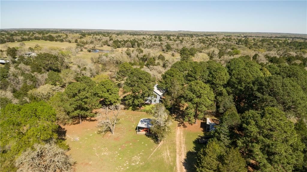 Beautiful private farm. Total of 60.007 acres (2 lots R57374 & R18111). Enjoy peaceful living in your 4 bedroom 2 bath house (2182 sq ft). Enjoy breakfast in your country kitchen with stone wood fireplace in living room, high ceilings, formal dining, zoned Central AC. Separate Guest house 1 bedroom 1 bath. Accessed by two public maintained roads. Please call agent for instructions on gate code.Guest Accommodations: Yes