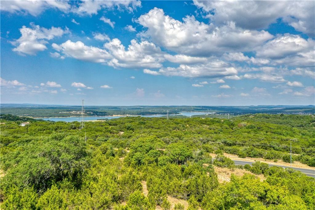 Many options.  Property sits up above road with good terrain.  Approximately 1300 +/- feet of road frontage.  Property has views of hill country  and lake to the west north west.  City water and sewer are relatively close by.  Any use would need to be approved by Lago Vista as it is in their ETJ. Seller makes no warranties as to the accuracy of any plats or information regarding utilities etc.  Buyer should confirm with new surveys and consulting the city  as to allowable uses and access to utilities.Restrictions: Yes