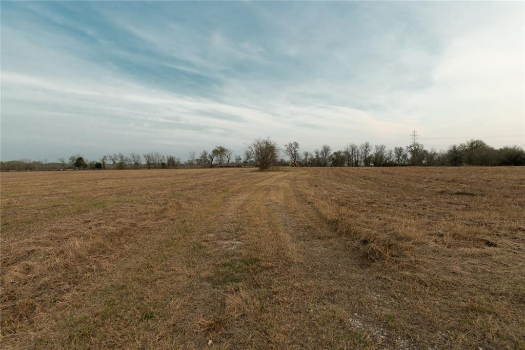 Beautiful fenced pasture land that is unrestricted located right past the Red Rock Elementary on the same side with 752 if frontage on Hwy 20. Two water lines on property. Lots of possibilities. Agents see gate code attached.