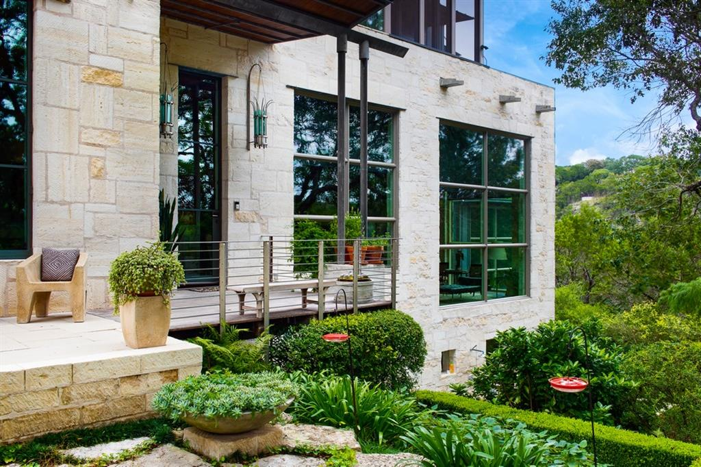 Created by Mell Lawrence, AIA, & featured on AIA Tour. Exclusive private treehouse setting literally above Barton Creek. Stunning juxtaposition of textures, materials & light. Gorgeous/functional/amazingly equipped + catering kitch/wine rm. Luxe master retreat w/ views. Living/entertaining incl media/library/music areas. Pvt guest suite+guest space detached. Outdoor cooking, dipping pool & path directly to Barton Creek. Only for those seeking exceptional quality combined w/ dramatic architecture.Restrictions: Yes