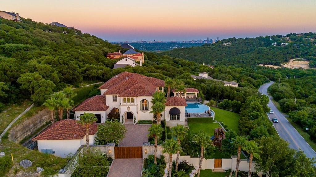 Stately Italian villa in the Westlake area conveniently located in the desirable Eanes ISD. Indoor/outdoor nirvana enhanced by 270-degree unobstructed views spanning Westlake's canyon hills.  Recently updated by the award-winning Crowell Builders, the interior maintains the heart of the original old-world elegance with an updated contemporary style. Features media room, two full master suites, office, pool/spa and MORE. 24 hour advance showing notice.Guest Accommodations: Yes  Sprinkler Sys:Yes