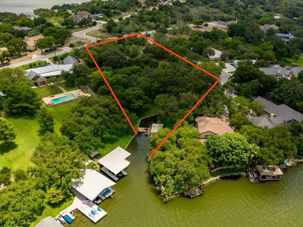 Wonderful opportunity to build the ultimate Dream Home on 2 ACRES wi/220+foot of waterfront in Blue Lake Estates on Lake LBJ. Possibilities are endless: Re-plat into different Waterfront & Hill Country-Lake View homesites for multiple homes or Build a Spectacular Waterfront Estate. The property has beautiful large trees situated thruout the property & gently slopes down to the peaceful private cove. Views of Lake & the Hill Country are beautiful. There is a comfortable 4bed/3bath home with lovely views.Restrictions: Yes