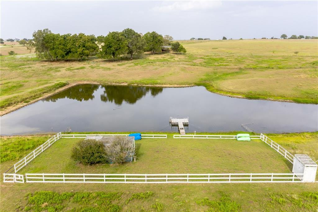 3/2 home at 425 ft altitude w/panoramic views of surrounding countryside! 1 acre spring-fed, pond w/floating dock, screen shaded 12x24 gazebo. Home w/huge covered porches, 2260 SF, for relaxing. Playscape area for kids, outdoor party area w/firepit shaded by live oaks. Wonderfully landscaped including newly planted, producing, fruit orchard! State maintained paved road frontage w/low volume traffic. 15 minutes to I-10, Hwy 71, La Grange, Schulenburg.