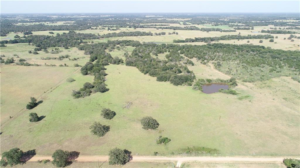 Ideal place to hunt, fish, run livestock, & for a homestead. Fully fenced w/1 large pond & seasonal creek. Has deer, feral hogs to come hunt, plus doves, ducks! Improved pasture grazing for cattle/horses. Mixture of hardwoods, mesquite, cedar & small brush to support wildlife. Additional water sites. Elec. on property & coop water close by. 2 gate entrances w/CR frontage near the end of dead end road. Short drive to Lexington or Giddings. Portable pens, mineral & deer feeders, deer stands are negotiable.