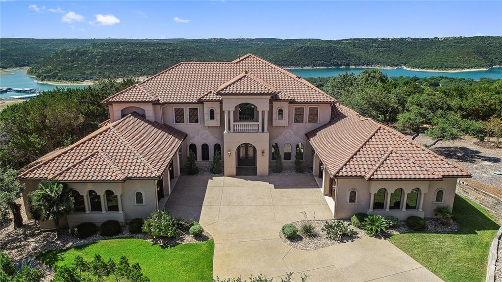 This one of a kind, palatial 7400+ sq ft estate sits on a 7.02 acre lot perched above Lake Travis - private gated neighborhood with only two other homes. Relax on one of the multiple outdoor living patios & catch breathtaking Texas sunsets. This extravagant property is located a short 30 min drive to downtown Austin or to the University of Texas Campus, 25 minutes from Domain and corporations such as Indeed, Apple and IBM.  An entertainers delight for all.  Zoned to Top Ranked Vandegrift High School.Guest Accommodations: Yes Restrictions: Yes  Sprinkler Sys:Yes  Virtual Walk-through can be seen here.  https://my.matterport.com/show/?m=PJXmuyBSoWw
