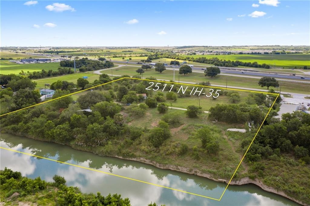 7.82 acre DREAM SITE with 483' of Blanco River frontage and 639' of I-35 Turnaround Access frontage. The original home was flooded in the 500-year flood of 2015, but was never flooded previously (or since 2015). This property is located outside of city limits in the ETJ, allowing for potential commercial use/development.