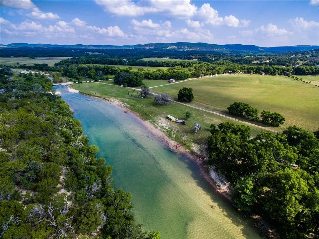 """Endless Possibilities!"""" Beautiful Hill Country Ranch located along spring fed Medina River. Designed for camp & retreat center. 21 cabins, 4 bath houses,great hall w/ commercial kitchen, Main House 3297sqft 3-2 Ranch Hme, Carriage house w/ 2 upstrs apts, 50,000gal. water tank for the ranch , 12 RV hook ups- 50 amp, Jr Olympic swimming pool, cvd full length basket ball ct, lge  barn swing, rock wall, vertical playground , volleyball court, tennis cts, scenic running trl, fabulous fishing & kayaking.Guest Accommodations: Yes"""