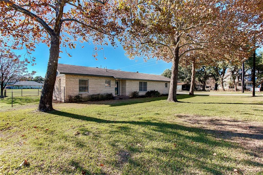 Great investment opportunity in booming downtown Liberty Hill, TX. This .25 acre lot includes a 1716 sqft home/office building ideal for business or development use. With C2 or Residential zoning the possibilities are endless. Corner lot with 241 feet of road frontage. City sewer, water & electric on property. Just a few blocks from HWY 29, walking distance in downtown & next door to the new Main Street Social. This town's growth is phenomenal! *The 2 acre lot next door is also for sale-see agent*Restrictions: Yes