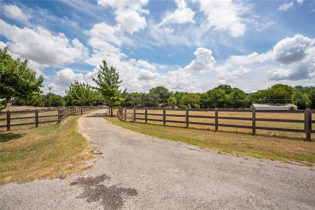 A secluded gentleman's 6 acre ranch practically in the city.Horse safe wood fence, barn, giant oaks, lush private setting.3 separate septic sites&versatility,2 masters, w/open plan, backs up to park minutes to town, Old Settlers, Dell Diamond & new Kalahari resort.4 stall barn, separate septic for a trailer pad.,perfect for an extended family. Huge garden. 2 large horse pastures, a rare opportunity.  ..\close to the city, acreage, privacy, oaks, what more can you ask for? dont overlook virtual, drone view