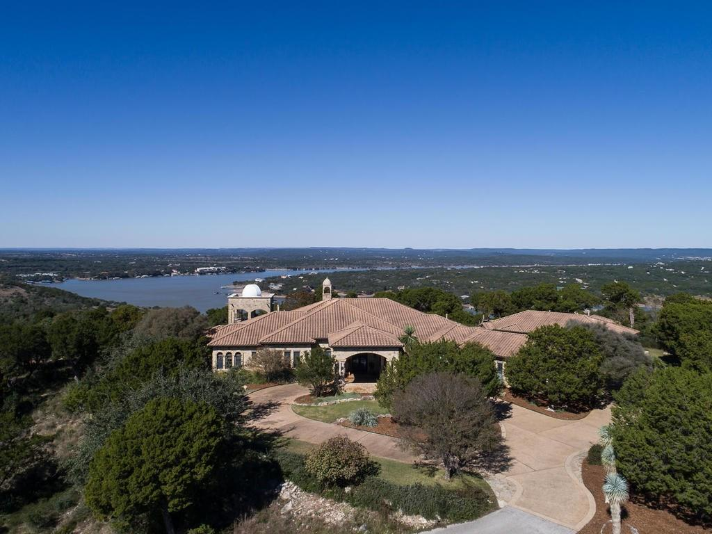Rare 55 acre Estate offering Panoramic Lake Views. This property will be appealing to many buyers;  Acreage Estate, Family Compound, or sub dividable. Walnut & Stone Floors, 3 Bedroom Suites, Office / Study, Exercise Room, Gourmet Kitchen. Guest Casita has full Kitchen, Bath, Living, Garage. Additional Detached Garage / workshop. Located within 1 mile of the Reserve at Lake Travis  for Lake Access. Close to Lake Travis Schools & the Hill Country Galleria.Guest Accommodations: Yes Restrictions: Yes  Sprinkler Sys:Yes