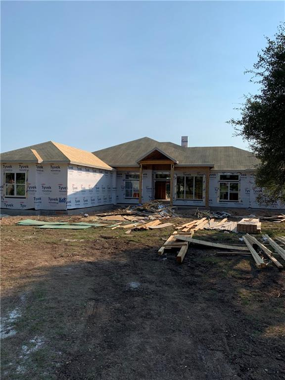 This beautiful home is under construction by Chance Leigh Custom Homes. Estimated completion is April/May 2021. The builder has a documented reputation for quality custom homes and this home will be nothing less than hand troweled wall, wood floors, 8'interior doors, spray foam walls and attic, 2 tankless water heaters, Kitchenaid appliances, over sized 3 car garage with epoxy floors, outdoor fireplace, grill and sink. All this with a flat rectangular tree'd lot with plenty of room for a pool or shop.Restrictions: Yes