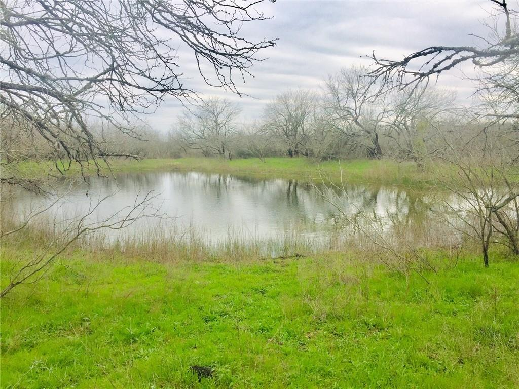 Approximately 19 acres of unrestricted fenced ag exempt land has utilities, water, electric, septic, 2020 mobile home, pool, pole barn, creek, pond. 1 mile West from Hwy 21 off FM 2001. Prime property close to Austin, Bergstrom, 130, 183, 4 miles to I35.Surveyed gated private driveway. Will sale in 2 parcels splitting off into 2 or even 3 sections of this land. Listings under lots and residential in a 13 acre and 6 acre listing. Very nice views.  There is a recently purchased mobile home by the pool and pole barn with chicken coop on 13 acres, and 6 acre lot with pond and creek with water and electric lines off private road.