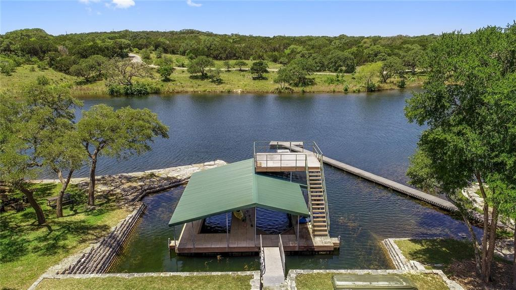 Private 19 acre deep, cool spring fed lake. Epic Heritage oaks on 205 acres of scenic rolling hills. Resort style master with kitchen and huge veranda overlooking lake. Plus 2 cabins bathes. Boat dock with 4 slips covered by a second story viewing deck. Fishing pier & boat ramp. Hunting, fishing great family or corporate retreat. No restrictions no ETJ. Acclaimed Dripping Springs ISD. Only 15 miles to Austin between beautiful Dripping Springs & Wimberley. Wildlife exempt for low taxes. Gated & fenced.Guest Accommodations: Yes
