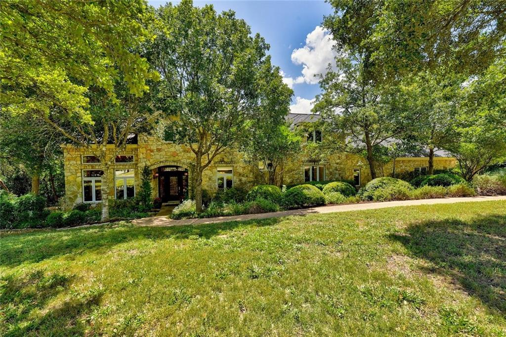 First time to market from original owners. Rare 1-acre property in the highly sought after Las Lomas community (adjacent to Rollingwood), minutes away from Zilker Park. Part of the acclaimed Eanes ISD. Designed by Jim LaRue, home has a large kitchen and open layout great for living and entertaining. High ceilings, large windows and French doors provide tons of natural light. Bonus upstairs 5th bedroom/office. Corner lot. Large circular driveway with lots of parking. Potential for pool in back.Restrictions: Yes  Sprinkler Sys:Yes