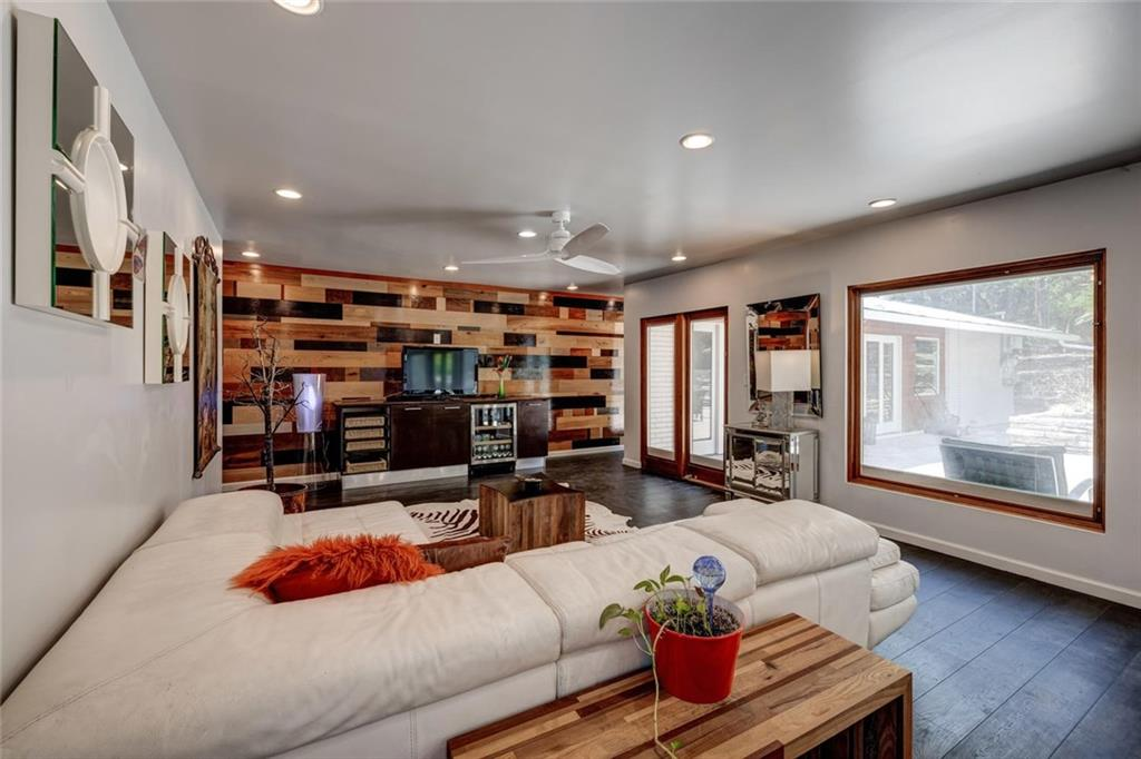 Gorgeous remodel in NW Hills near Mt. Bonnell!  Builder's extraordinaire, complete w/ solar panels, tankless water heater, Pella doors, energy rated windows, new AC compressor July 2020. Custom cabinetry in office & family room, tons of storage, perfect for home office.  Beautiful backyard w/ tiered stone walls & huge patio.  Multiple accent walls, barn doors. Two-seater Kohler spa tub, Dutch hardwood flooring.  Outdoor kitchen perfect for entertaining; Lynx grill, & mini-fridge. Welcome to the good life! Sprinkler Sys:Yes