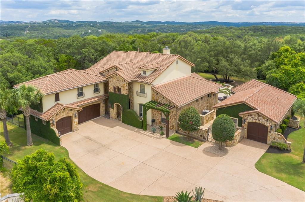 Here's a Steiner Ranch home located in the UT Golf Club that you won't see come on the market very often, if ever. An aerial view reveals the private cul-de-sac setting that has you surrounded by the 11th and 12th holes. Enjoy a spacious 7 bedroom/9 bathroom layout along with a pool, hot tub, a cabana with a full outdoor kitchen and living space that will make you feel like you're on a permanent vacation in your backyard. Make it yours and get ready to entertain your family and friends in style.