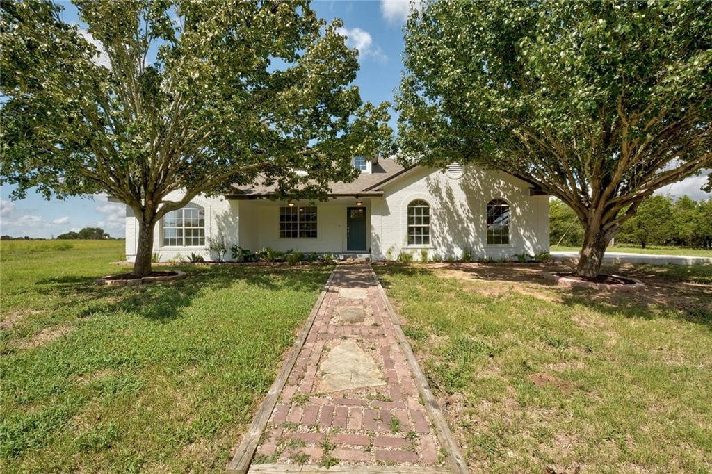 674 feet of FM 535 frontage! Awesome remodel!  3 bedroom, 2 baths on 10 acres.  Living room with brick fireplace. Study with barn door. White kitchen with center island, stainless steel appliances and lots of counter space.  Build in book shelves.  Master with master bath that  features double vanities, garden tub, separate shower and a walk in closet.  Second bath has a garden tub and separate shower.  Patio in back to enjoy private backyard.Restrictions: Yes