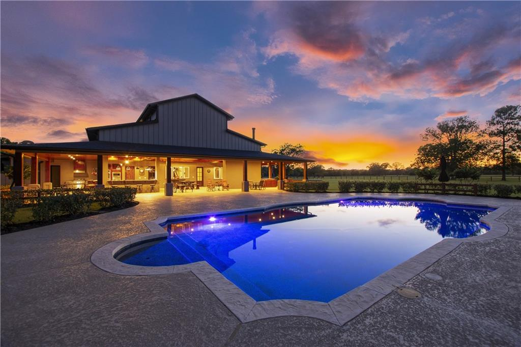 Posh highly sought after Gentleman's Ranch 100 + -acres w/ Barn Dominium plus elite studio Bldg., & guest Qtrs. Step into custom beauty built inside. Kitchen open to the living room for family pleasure. Granite counter tops, wood cabinets,butler's pantry,Wine area, high ceilings, exercise room and stairs to a large loft. Pictures help you see the beauty like none other. Walk out to a kitchen you only dream about, fireplace, pool, horse stalls, equip. sheds, Sauna, ponds on property, unrestricted.Guest Accommodations: Yes