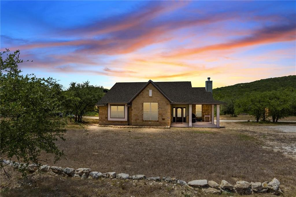 Three year old Tilson custom home on 7.97 acres with frontage on Collier Creek. Great combo of open space & woods Lots of room for animals & outdoor activities. Kitchen, dining, and living open in a Great room. Modern kitchen with lots of counter space. Fireplace with gas logs. MIL plan with panoramic view of woods & valley from MBR, dining, kitchen, & living room. Detached insulated metal barn/workshop. Good combination of open space and woods. Close to Lake Travis with access in Jones Brothers Park.